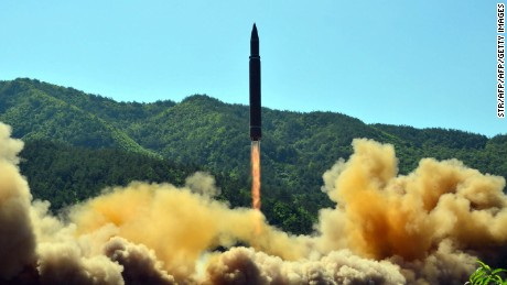 "TOPSHOT - This picture taken on July 4, 2017 and released by North Korea's official Korean Central News Agency (KCNA) on July 5, 2017 shows the successful test-fire of the intercontinental ballistic missile Hwasong-14 at an undisclosed location. South Korea and the United States fired off missiles on July 5 simulating a precision strike against North Korea's leadership, in response to a landmark ICBM test described by Kim Jong-Un as a gift to ""American bastards"". / AFP PHOTO / KCNA VIA KNS / STR / South Korea OUT / REPUBLIC OF KOREA OUT   ---EDITORS NOTE--- RESTRICTED TO EDITORIAL USE - MANDATORY CREDIT ""AFP PHOTO/KCNA VIA KNS"" - NO MARKETING NO ADVERTISING CAMPAIGNS - DISTRIBUTED AS A SERVICE TO CLIENTS THIS PICTURE WAS MADE AVAILABLE BY A THIRD PARTY. AFP CAN NOT INDEPENDENTLY VERIFY THE AUTHENTICITY, LOCATION, DATE AND CONTENT OF THIS IMAGE. THIS PHOTO IS DISTRIBUTED EXACTLY AS RECEIVED BY AFP.    /         (Photo credit should read STR/AFP/Getty Images)"