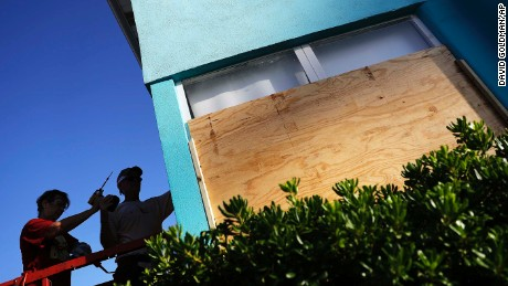 Paulita Kundid, left and her brother Mike Kundid board up their apartment building ahead of Hurricane Irma in Daytona Beach, Fla., Friday, Sept. 8, 2017. Coastal residents around South Florida have been ordered to evacuate as the killer storm closes in on the peninsula for what could be a catastrophic blow this weekend. (AP Photo/David Goldman)