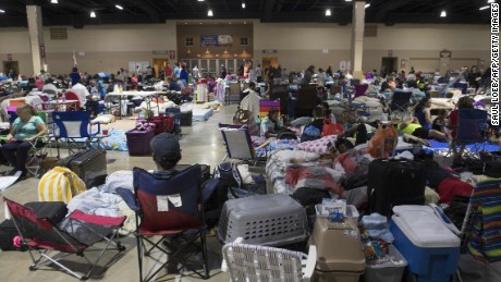 People settle into a shelter in Miami on Friday.