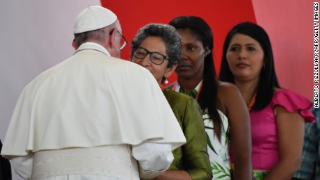 "Pope Francis greets Pastora Mira Garcia -a victim of Colombia's civil conflict- during a National Reconciliation Encounter at Las Malocas Park in Villavicencio, Colombia, on September 8, 2017.  On the third day of his trip to the country, Pope Francis held an open air mass ahead of a separate ""prayer for national reconciliation"" for victims and former guerrilla and state combatants. / AFP PHOTO / Alberto PIZZOLI        (Photo credit should read ALBERTO PIZZOLI/AFP/Getty Images)"