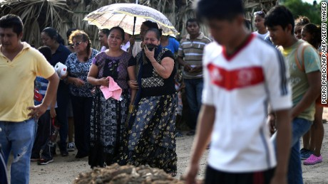 Mourners cry during the funeral of 85-year-old Casimiro Rey, one of the victims of an 8.2 magnitude earthquake that hit Mexico's Pacific coast overnight, on September 8, 2017 in Juchitan de Zaragoza, state of Oaxaca. Mexico's most powerful earthquake in a century killed at least 58 people, officials said, after it struck the Pacific coast, wrecking homes and sending families fleeing into the streets. / AFP PHOTO / PEDRO PARDO        (Photo credit should read PEDRO PARDO/AFP/Getty Images)