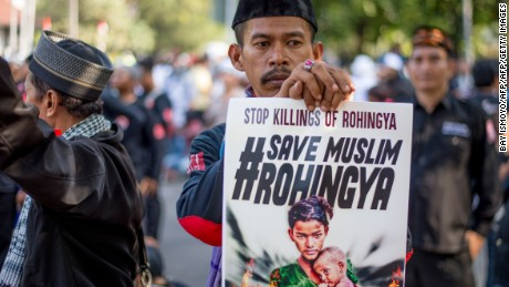 A protester holds a sign during an anti-Myanmar rally in Jakarta, Indonesia, on September 8, 2017.