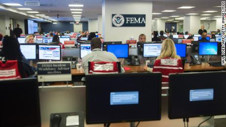 Employees work inside the command center at the Federal Emergency Management Agency headquarters in Washington on August 4, 2017.