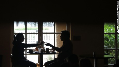 Hotel guests eat breakfast by window light after the Courtyard Marriott was left without power in Fort Lauderdale, Florida, on September 10.