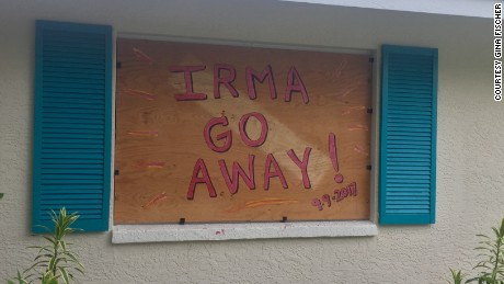 "Gina Fischer boarded up her North Naples home and left a message for the arrival of the storm, ""Irma go away!"""