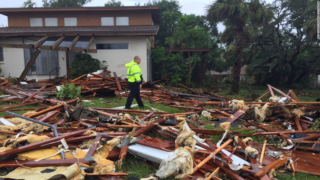 A police officer walks over debris after a tornado touched down in Palm Bay, Florida, on September 10.