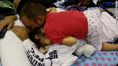 Little Mya fell asleep on her dad at a hurricane shelter in Estero.