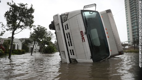 MIAMI, FL - SEPTEMBER 10:  A truck is seen on its side after being blown over as Hurricane Irma passed through on September 10, 2017 in Miami, Florida. Hurricane Irma, which first made landfall in the Florida Keys as a Category 4 storm on Sunday, has weakened to a Category 2 as it moves up the coast.  (Photo by Joe Raedle/Getty Images)