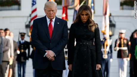 President Donald Trump and first lady Melania Trump stand at the White House for a moment of silence to mark the anniversary of the Sept. 11 terrorist attacks.