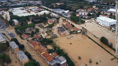 An aerial view of the city of Leghorn, Italy, following floods, Sunday, Sept. 10, 2017. Torrential rain in Italy has triggered flooding that killed at least five people in Tuscany. Italian state television said four of the victims were family members whose bodies were found in a flooded basement the Tuscan port town of Leghorn, also known as Livorno. Authorities said two people in the Leghorn area were missing.  (Vigili del Fuoco/Italian Firefighters via AP)
