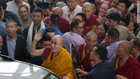 Tibetan spiritual leader the Dalai Lama greets devotees as he leaves after a religious talk at the Tsuglakhang temple in Dharmsala, India, Friday, Sept. 1, 2017. The four-day religious discourse by the Tibetan leader for Buddhist groups from Southeast Asian countries ended Friday. (AP Photo/Ashwini Bhatia)