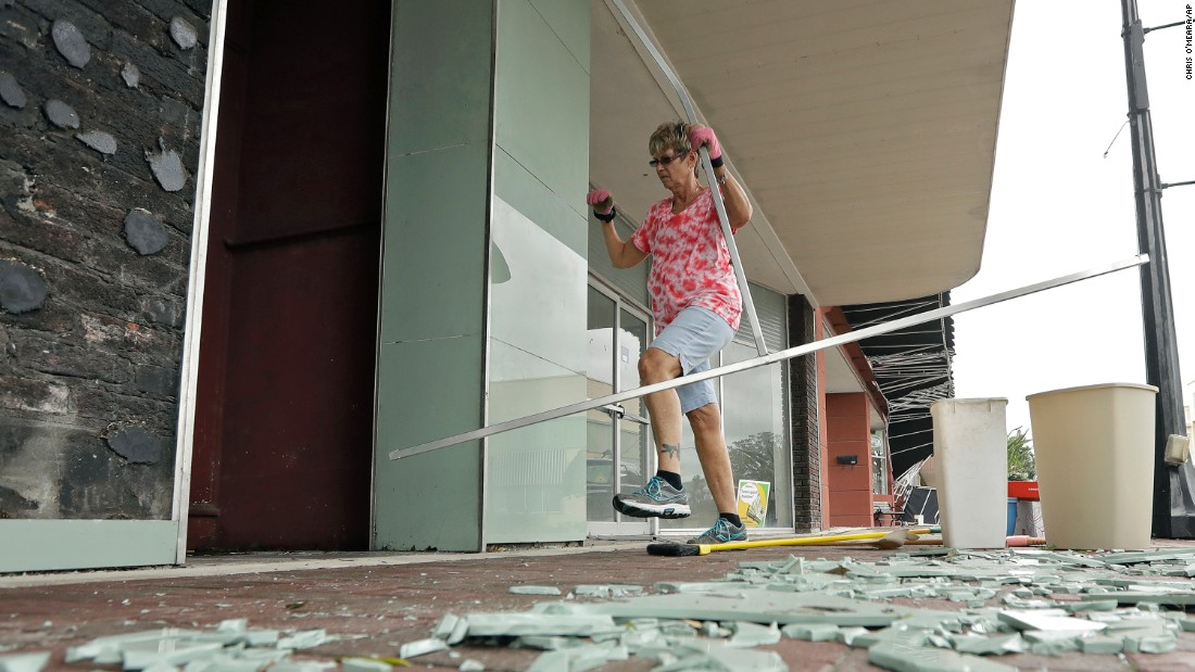Catharine Taylor Woods cleans up a broken awning outside her building in Wauchula, Florida, on September 11.
