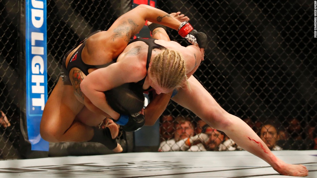 Valentina Shevchenko, right, wrestles UFC bantamweight champion Amanda Nunes on Saturday, September 9. Nunes won a split decision to retain her title.
