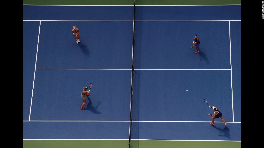 Chan Yung-jan, bottom right, returns a shot during the women's doubles final of the US Open on Sunday, September 10. Chan and Martina Hingis defeated Lucie Hradecka and Katerina Siniakova 6-3, 6-2.