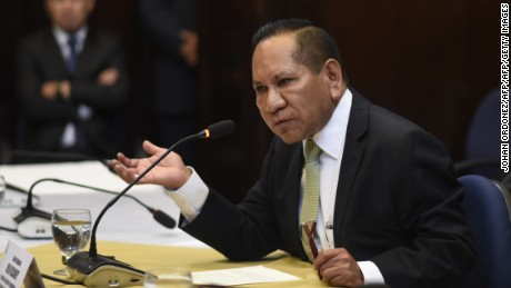 Guatemalan deputy Julio Ixcamey, head of the congressinal inquiry commission reads the decision to reccomed the revocation the presidential immunity to Jimmy Morales, in Guatemala City on September 11, 2017. Morales is under investigation by the UN International Committee Against Impunity in Guatemala (CICIG) and Guatemalan prosecutors for allegedly failing to declare $1 million in campaign funding to his party for his election in 2015. / AFP PHOTO / JOHAN ORDONEZ        (Photo credit should read JOHAN ORDONEZ/AFP/Getty Images)