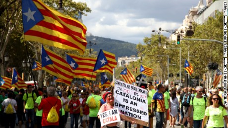 BARCELONA, SPAIN - SEPTEMBER 11:  People wave Esteladas (pro-independence flags) as they gather during a demonstration celebrating the Catalan National Day on September 11, 2017 in Barcelona, Spain. The Spanish Northeastern autonomous region celebrates its National Day on September 11 marked by the secession referendum of the next October 1 which was approved by the Catalan Parliament and banned by the Spanish Government.  (Photo by Sandra Montanez/Getty Images)