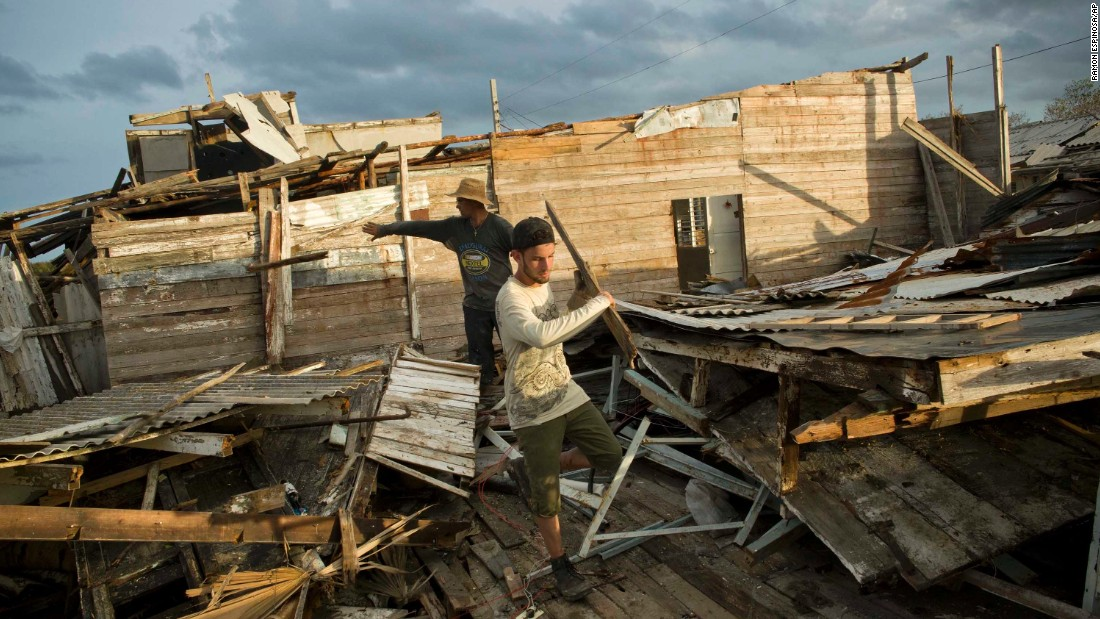 People salvage material from the remains of a house in Isabela de Sagua on September 11.