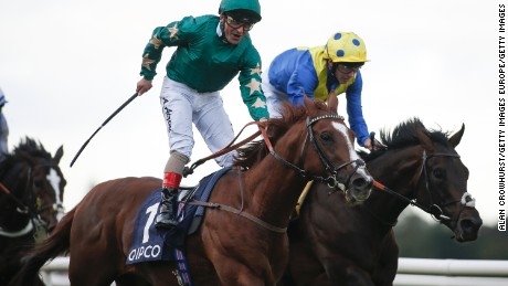 DUBLIN, IRELAND - SEPTEMBER 09:  Andrea Atzeni riding Decorated Knight (C, green) celebrate winning The Qipco Irish Champion Stakes at Leopardstown racecourse on September 9, 2017 in Dublin, Ireland. (Photo by Alan Crowhurst/Getty Images)