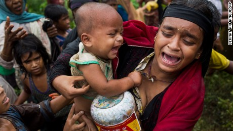 In this Sept. 8, 2017, photo, a Rohingya woman breaks down after a fight erupted during food distribution by local volunteers at Kutupalong, Bangladesh, Friday, Sept. 8, 2017. The massive refugee camp in Kutupalong was set up in the early 90s to accommodate the first waves of Rohingya Muslim refugees who started escaping convulsions of violence and persecution in Myanmar. Don't expect the United States to step in and resolve what is increasingly being describing as an ethnic cleansing campaign against Myanmar's downtrodden Rohingya Muslims. (AP Photo/Bernat Armangue)