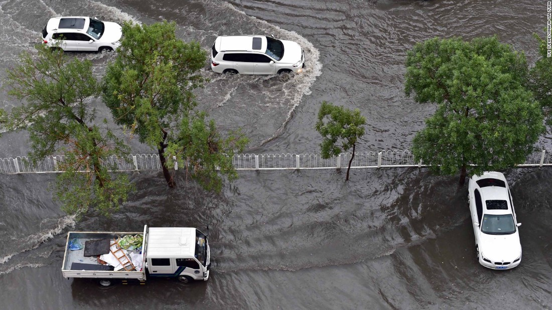 During the 2016 floods in Tianjin, an orange alert was issued -- during which time drivers navigated their vehicles through flooded roads.