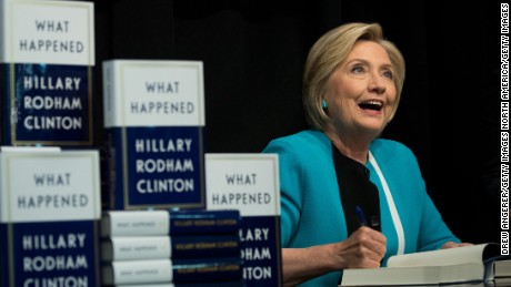 "NEW YORK, NY: Former U.S. Secretary of State Hillary Clinton signs copies of her new book ""What Happened"" during a book signing event at Barnes and Noble bookstore September 12, 2017 in New York City. Clinton's book, which focuses on her 2016 election loss to President Donald Trump, goes on sale today. (Drew Angerer/Getty Images)"