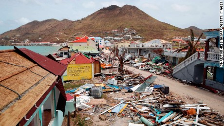 This general view shows buildings destroyed by Hurricane Irma on the French Caribbean island of Saint Martin on September 12, 2017, during the visit of France's President Emmanuel Macron . 