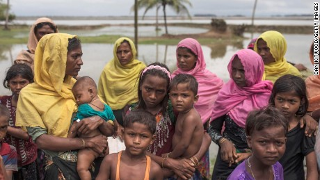DAKHINPARA, BANGLADESH - SEPTEMBER 08:  Rohingya Muslim refugees gather on the shoreline after arriving on a boat from Myanmar on September 08, 2017 in Dakhinpara, Bangladesh. Thousands of Rohingya continue to cross the border after violence erupted in Myanmar's Rakhine state when the country's security forces allegedly launched an operation against the Rohingya Muslim community.  (Photo by Dan Kitwood/Getty Images)
