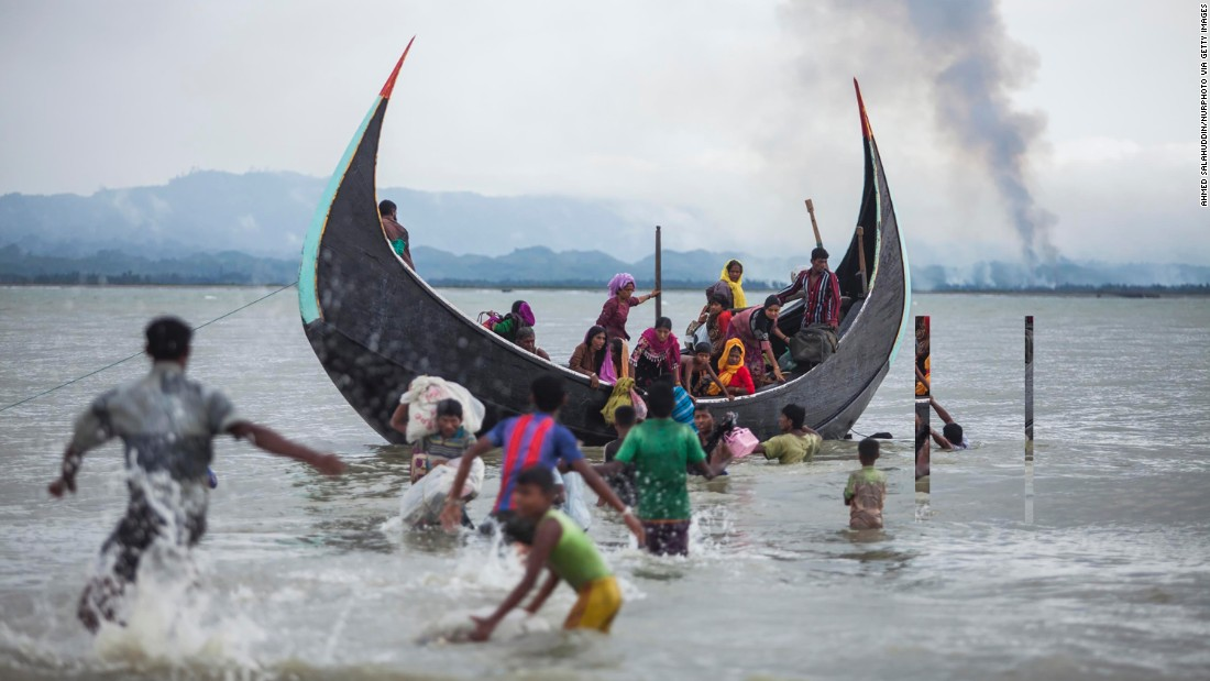 A boat full of Rohingya refugees arrives on September 9, on the Bangladeshi side of the Naf River.