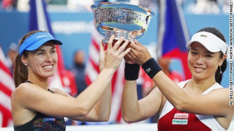 NEW YORK, NY - SEPTEMBER 10:  Martina Hingis of Switzerland and Yung-Jan Chan of Taiwan hold the championship trophy after defeating Lucie Hradecka of Czech Republic and Katerina Siniakova of Czech Republic after their Women's Doubles finals match on Day Fourteen of the 2017 US Open at the USTA Billie Jean King National Tennis Center on September 10, 2017 in the Flushing neighborhood of the Queens borough of New York City. Chan and Hingis won the match in the second set with a score of 6-3, 6-2.  (Photo by Al Bello/Getty Images)