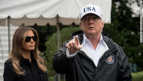 US President Donald Trump speaks to the press with First Lady Melania Trump before they depart the White House in Washington, DC, on September 14, 2017 for Florida.