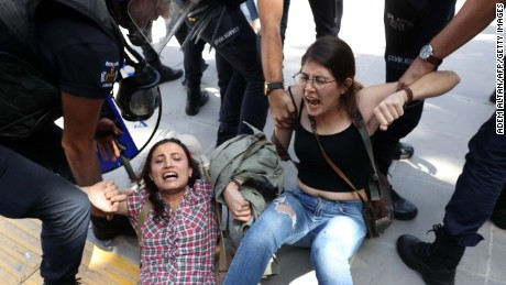 Riot police detain protesters outside a courthouse in Ankara on Thursday.