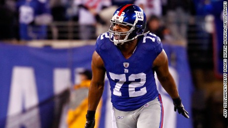 EAST RUTHERFORD, NJ - JANUARY 01:  Osi Umenyiora #72 of the New York Giants reacts after a tackle against the Dallas Cowboys at MetLife Stadium on January 1, 2012 in East Rutherford, New Jersey.  (Photo by Jeff Zelevansky/Getty Images)