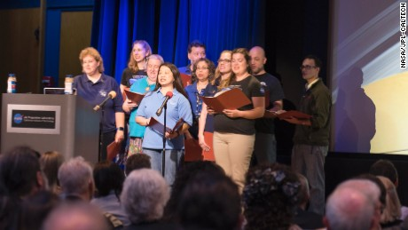 The Cassini Virtual Singers perform space-centric parodies of popular songs in front of a crowd at NASA's Jet Propulsion Laboratory in Pasadena, California.