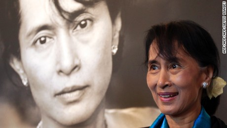 Myanmar democracy icon Aung San Suu Kyi tours the Nobel Peace center in Oslo on June 16, 2012. Suu Kyi on June 16 pledged to keep up her struggle for democracy as she finally delivered her Nobel Peace Prize speech, 21 years after winning the award while under house arrest.    AFP PHOTO / POOL /Cathal McNaughton        (Photo credit should read Cathal McNaughton/AFP/GettyImages)