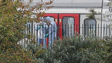 "Police forensics officers works alongside an underground tube train at a platform at Parsons Green underground tube station in west London on September 15, 2017, following an incident on an underground tube carriage at the station. British police are treating an incident on a London Underground train on Friday as an act of terrorism, saying ""a number of people"" had been injured. ""Terrorist incident declared at Parsons Green Underground Station,"" police said in a statement.  / AFP PHOTO / Daniel LEAL-OLIVAS        (Photo credit should read DANIEL LEAL-OLIVAS/AFP/Getty Images)"
