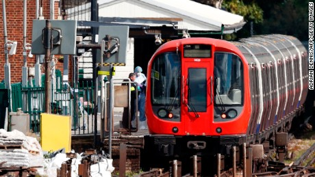 Investigators inspect a train where a blast occurred at the Parsons Green station in central London on September 15.