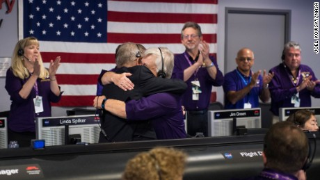 Cassini program manager Earl Maize, left, and spacecraft operations team manager for the Cassini mission at Saturn, Julie Webster, right, embrace after the Cassini spacecraft plunged into Saturn.