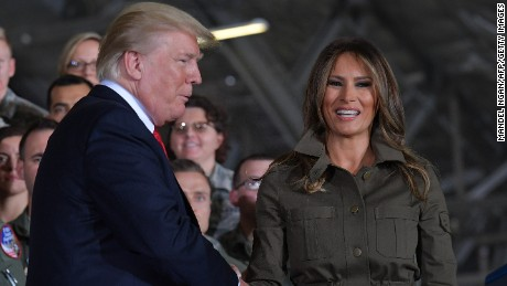 US President Donald Trump (L) shakes hands with US First Lady Melania Trump after she spoke to members of the military at Joint Andrews Airforce base, Maryland on September 15, 2017. (MANDEL NGAN/AFP/Getty Images)