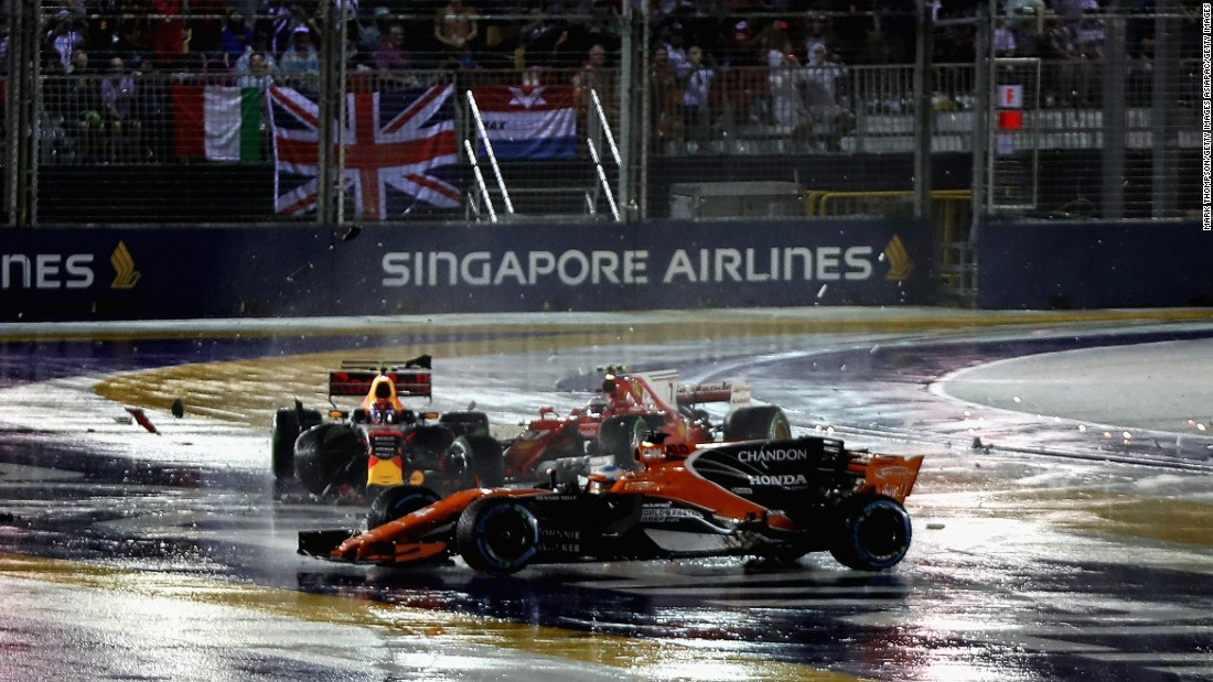 Fernando Alonso (foreground) was caught up in the crash between Max Verstappen and Kimi Raikkonen at the start of the Singapore Grand Prix