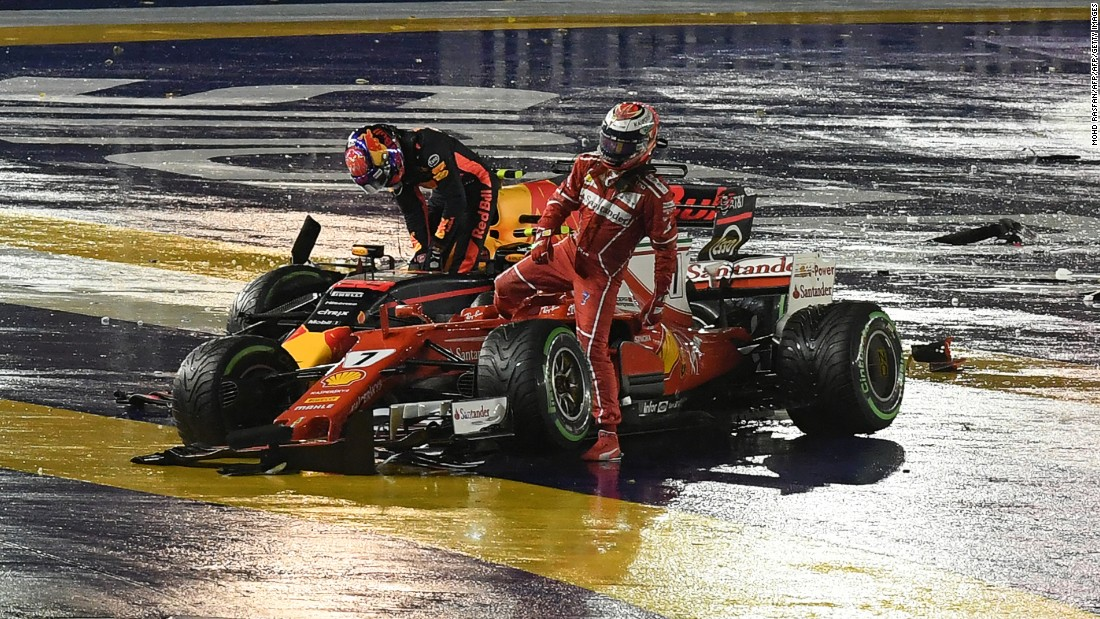 Kimi Raikkonen (right) and Max Verstappen step out of their cars after colliding at Sunday's Singapore Grand Prix