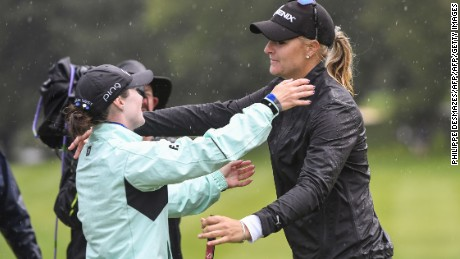 Nordqvist and runner-up Brittany Altomare (left) embrace in the rain after the Swede clinched the title.