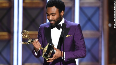 "Donald Glover accepts the award for outstanding directing for a comedy series for the ""Atlanta"" episode ""B.A.N."" at the 69th Primetime Emmy Awards."