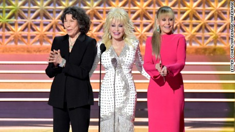 Lily Tomlin, Dolly Parton, and Jane Fonda speak  onstage during the 69th Annual Primetime Emmy Awards.