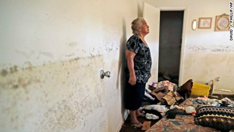 Florentina Amaya, 71, contemplates the mold growing inside her Houston home in the aftermath of Hurricane Harvey.