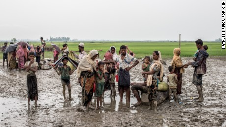 In Bangladesh, tens of thousands of refugees flee over the border from Burma.