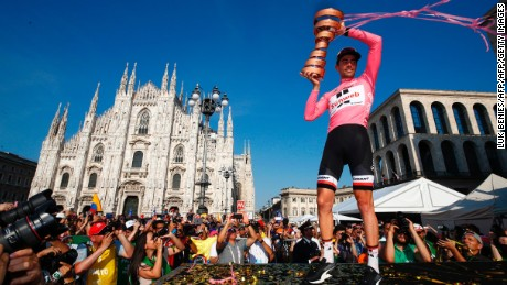 The winner of the 100th Giro d'Italia, Netherlands' Tom Dumoulin of team Sunweb, holds aloft the trophy near Milan's cathedral in May 2017.