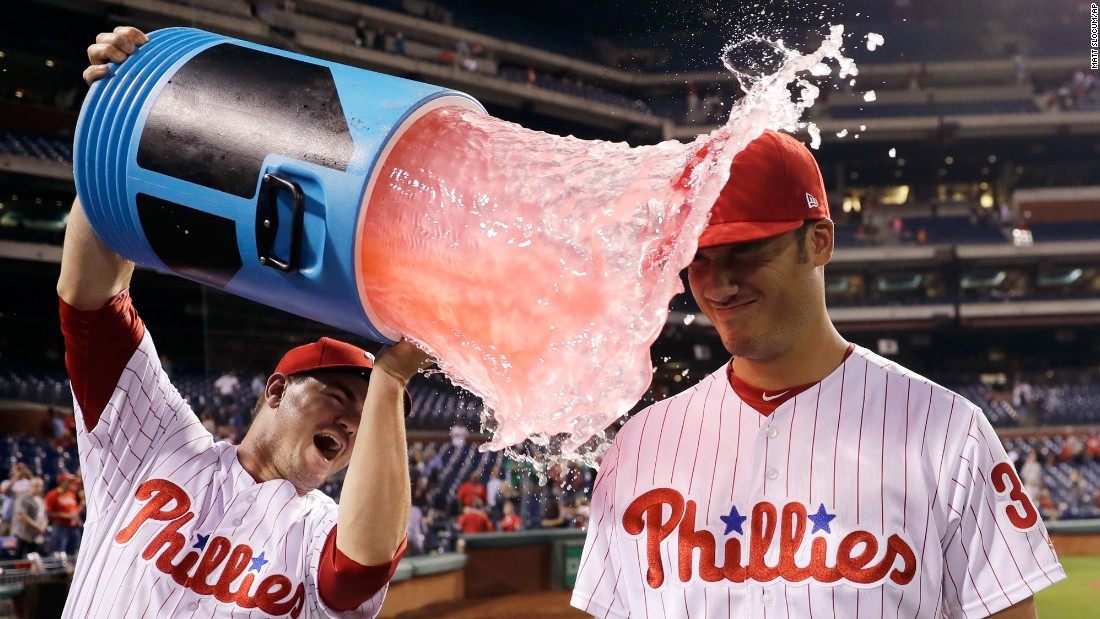 Philadelphia rookie Cameron Perkins is doused by teammate Tommy Joseph after the Phillies' 10-0 victory against Miami on Thursday, September 14. Perkins hit his first career home run during the game.