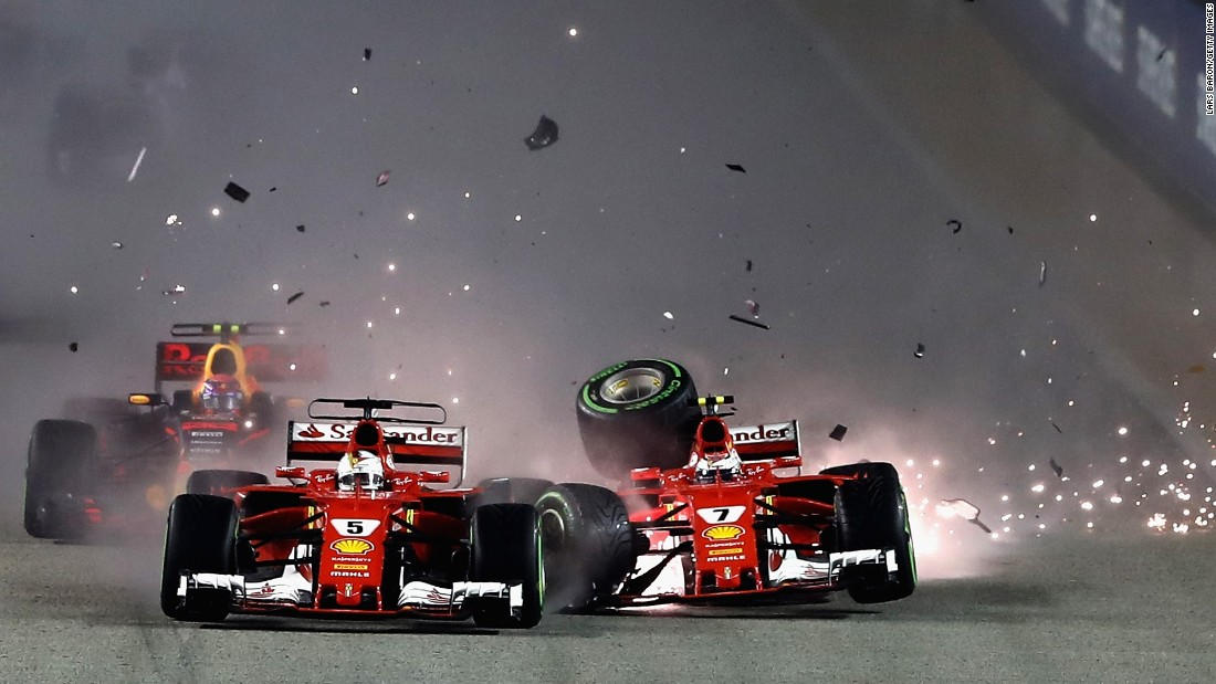 "Ferrari teammates Sebastian Vettel, left, and Kimi Raikkonen collide at the start of <a href=""http://www.cnn.com/2017/09/17/motorsport/singapore-gp-f1-rain-vettel-hamilton-verstappen-ricciardo-ferrari/index.html"" target=""_blank"">the Formula One race in Singapore</a> on Sunday, September 17. Lewis Hamilton won the rain-soaked race."