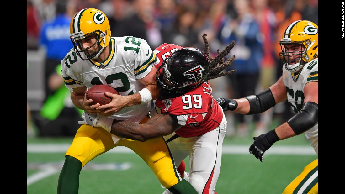 Green Bay quarterback Aaron Rodgers is sacked by Atlanta's Adrian Clayborn during an NFL game on Sunday, September 17. The Falcons sacked Rodgers three times and won 34-23 in what was a rematch of last year's NFC Championship. It was the first regular-season game played at Atlanta's new Mercedes-Benz Stadium.