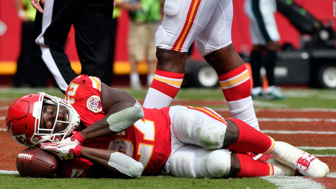 Kansas City running back Kareem Hunt pretends to sleep on the ball after scoring a touchdown against Philadelphia on Sunday, September 17. The NFL has relaxed its rules this year on touchdown celebrations.